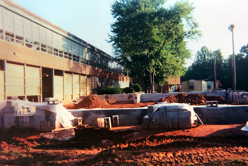 Photograph of a new classroom wing under construction.